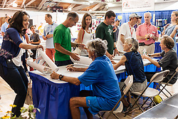 Frank Shorter signs autographs at expo with Joan Samuelson and Bill Rodgers
