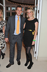 SAM BARRINGTON-WELLS and GRACE PILKINGTON at the Veuve Clicquot Mint Polo in The Park after party held at The Hurlingham Club, Ranelagh Gardens, London SW6 on 5th June 2011.