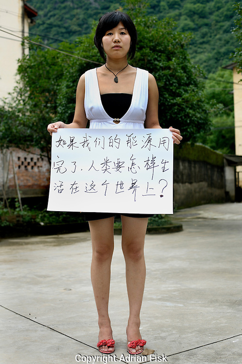 Xie Xin - 21 Yrs.<br /> Student of business management in Beijing but learning english in Guangxi.<br /> Guangxi Province.<br /> <br /> 'If we consume all our energy, how can mankind live in this world'.