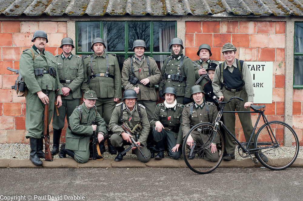 Reenactors portraying German panzer Grenadiers pose for a group photograph at Eden Camp Malton Nr Pickering<br /> Eden Camp 2012 NWW2A Membership Weekend<br /> http://www.pauldaviddrabble.co.uk<br /> 3 March 2012<br /> Image &copy; Paul David Drabble