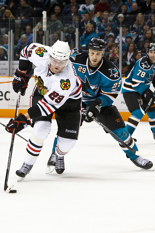 December 11, 2010; San Jose, CA, USA;  Chicago Blackhawks left wing Bryan Bickell (29) skates past San Jose Sharks right wing Ryane Clowe (29) during the third period at HP Pavilion.  San Jose defeated Chicago 2-1 in overtime. Mandatory Credit: Jason O. Watson / US PRESSWIRE