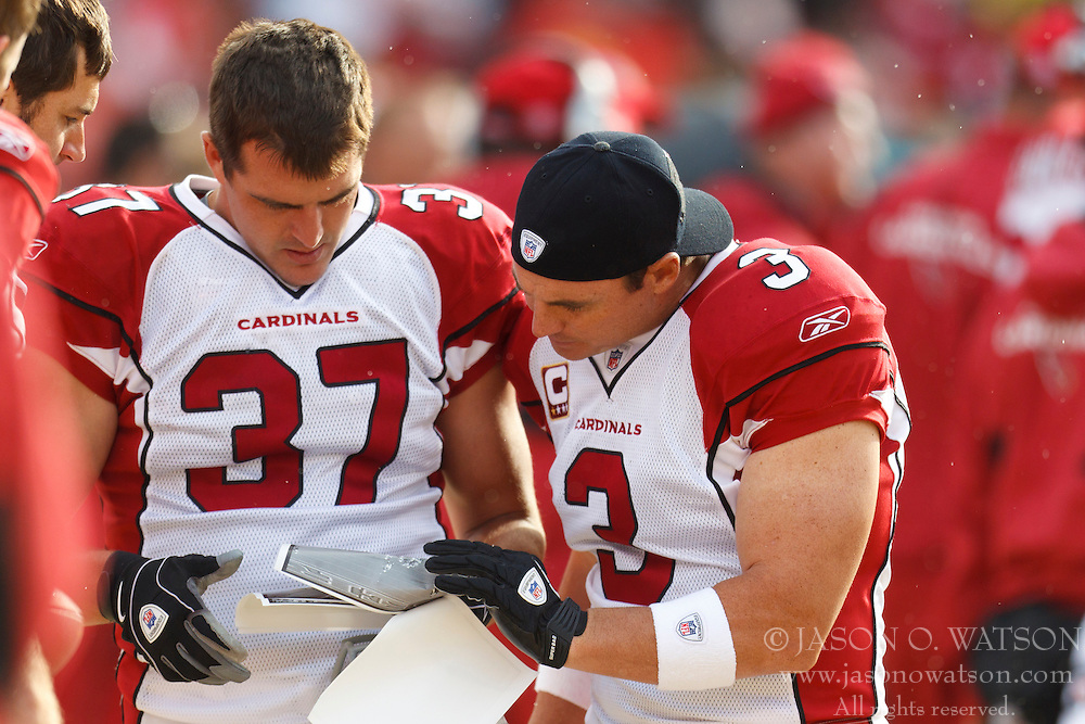 Nov 20, 2011; San Francisco, CA, USA; Arizona Cardinals defensive back Sean Considine (37) and kicker Jay Feely (3) review print outs of aerial photographs of previous plays on the sidelines against the San Francisco 49ers during the second quarter at Candlestick Park. San Francisco defeated Arizona 23-7. Mandatory Credit: Jason O. Watson-US PRESSWIRE