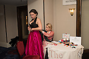 CHLOE SMITH HAVING EMERGENCY DRESS REPAIR FROM  EMILY ROSE WETHERELLThe Royal Caledonian Ball 2016. Grosvenor House. Park Lane, London. 29 April 2016