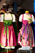 Traditional Tyrolean dirndl dresses in shop window in Herzog Friedrich Strasse in Innsbruck in the Tyrol, Austria