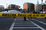 A police line blocks access to the area where two explosions killed three people near the Boston Marathon finish line on April 15, 2013.
