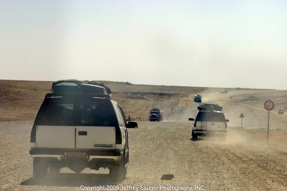 Vehicles head south toward Baghdad, Iraq, as gas tankers head north along a detour around a bombed out bridge on the Iraq Al Walaed freeway.The Al-kasid family finally cleared the Syrian-Iraqi border at about 8:30a.m. Sunday, July 20, 2003. The family is travelling back to its home city of Nassiriyah, Iraq, for the first time since 1991 after fighting in the failed uprising against Saddam Hussein, fleeing to a refuge camp in Saudi Arabia for 3 years and finally settling in Dearborn, MI.