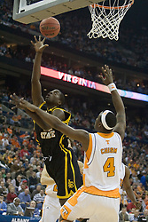 Long Beach State 49ers forward Dominique Ricks (44) shoots over Tennessee Volunteers forward Wayne Chism (4).  The #5 seed Tennessee Volunteers defeated the #12 seed Long Beach State 49ers 121-86  in the first round of the Men's NCAA Tournament in Columbus, OH on March 16, 2007.
