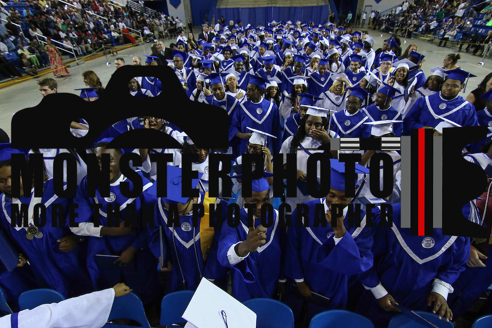 Howard graduates comprised of 186 students celebrate after Howard High School of Technology 146th commencement exercises Thursday, June 04, 2015, at The Bob Carpenter Sports Convocation Center in Newark, Delaware.