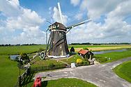Een van de molens van de molendriegang in het polderlandschap bij Stompwijk - Mill in dutch lowland landscape
