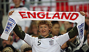 An England fan / supporter holds up an England scarf