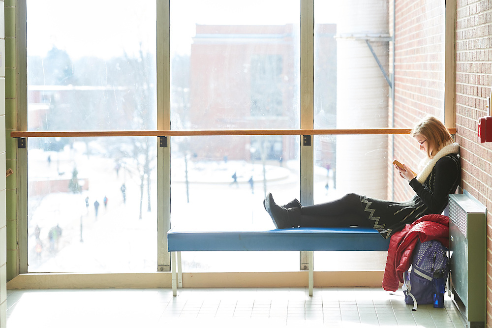 Activity; Relaxing; Reading; Buildings; Cowley; Location; Inside; Objects; Books; Couch; People; Student Students; Woman Women; Time/Weather; day; sunny; Type of Photography; Candid; UWL UW-L UW-La Crosse University of Wisconsin-La Crosse; Winter; January