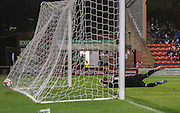 Artur Krysiak looks on as James Berrett's shot deflects past him during the Sky Bet League 2 match between York City and Yeovil Town at Bootham Crescent, York, England on 18 August 2015. Photo by Simon Davies.