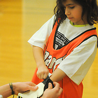 Gabby Mediratta puts on goalie gloves before the Wilmington Hammerheads' Youth Outreach Indoor Friendly Tournament Sunday January 11, 2015 at the MLK Center in Wilmington, N.C. (Jason A. Frizzelle)