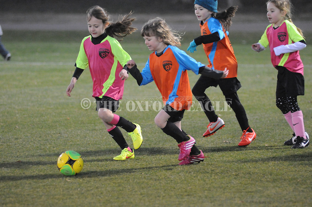 The Fillies' Kate Nordstrom (second from l.) vs. the Blue Jays' Poppy Boling (left) in Oxford Park Commission girls U6 soccer action at FNC Park in Oxford, Miss. on Tuesday, February 10, 2015.