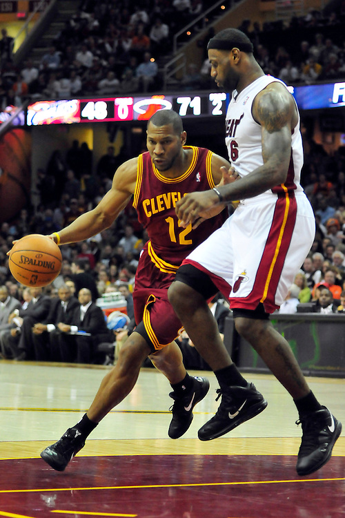 Dec. 2, 2010; Cleveland, OH, USA;  Cleveland Cavaliers shooting guard Joey Graham (12) drives around Miami Heat small forward LeBron James (6) during the third quarter at Quicken Loans Arena. The Heat beat the Cavaliers 118-90. Mandatory Credit: Jason Miller-US PRESSWIRE