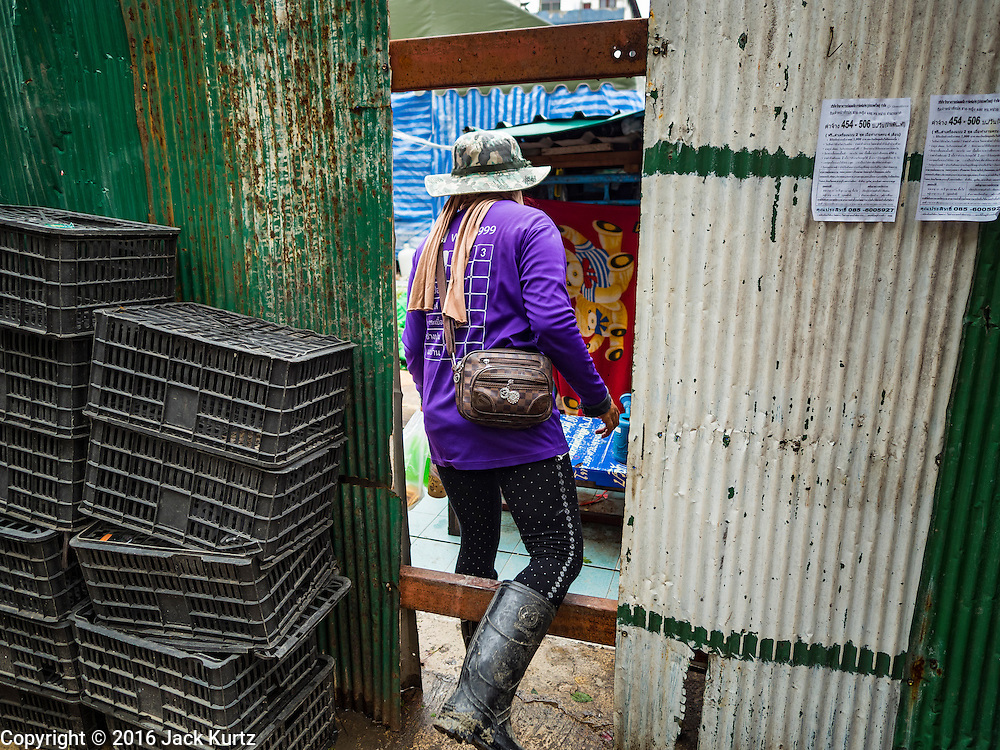 21 SEPTEMBER 2016 - BANGKOK, THAILAND: A worker goes int the construction site now occupying the land that used to be the Bang Chak Market. The market closed permanently on January 4, 2016. The Bang Chak Market served the community around Sois 91-97 on Sukhumvit Road in the Bangkok suburbs. Bangkok city authorities put up notices in late November 2015 that the market would be closed by January 1, 2016 and redevelopment would start shortly after that. Market vendors said condominiums are being built on the land.      PHOTO BY JACK KURTZ