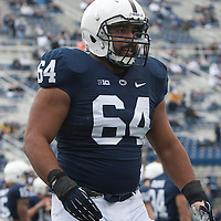 Guard John Urschel #64 of the Penn State Nittany Lions warms up on the field prior to a game against the Illinois Fighting Illini on November 2, 2013 at Beaver Stadium in University Park, Pennsylvania.