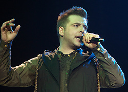 "Westlife Greatest Hits / Farewell Tour 2012 at the Metro Radio Arena Newcastle..15-06-12... ..Mark Feehily of  Irish Super Group Westlife perform during their sell out show at the Metro Radio Arena, in the English Leg of their Greatest Hits / Farewell World Tour. ..Westlife are an Irish boy band formed in 1998. They are to disband in 2012 after their farewell tour. The group's line-up was Shane Filan, Mark Feehily, Kian Egan, and Nicky Byrne. Brian McFadden was part of the group until 2004. Westlife have sold over 45 million records worldwide which includes studio albums, singles, video release, and compilation albums.. Despite the group's worldwide success, they only have one hit single in the United States, ""Swear It Again"", which peaked in 2000 on the Billboard Hot 100 at number 20. The band were originally signed by Simon Cowell and are managed by Louis Walsh. The group have accumulated 14 number-one singles in the United Kingdom, the third-highest in UK history, tying with Cliff Richard..The group had also broken a few records, including ""Music artist with most consecutive number 1's in the UK"", which consists of their first seven singles and only behind The Beatles and Elvis Presley..The band have 14 UK number ones and 25 top ten singles, consisting of 20.2 million records and videos in the UK across their 14-year career - 6.8 million singles, 11.9 million albums and 1.5 million videos. The Band are best known for amazing songs such as Flying Without Wings and Safe......At The Metro Radio Arena, Newcastle. England..Picture  Mark Davison/ ProLens PhotoAgency/ PLPA..Friday 15th June 2012."