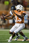 AUSTIN, TX - SEPTEMBER 19:  Jerrod Heard #13 of the Texas Longhorns is brought down by his facemask by James Looney #9 of the California Golden Bears during the third quarter on September 19, 2015 at Darrell K Royal-Texas Memorial Stadium in Austin, Texas.  (Photo by Cooper Neill/Getty Images) *** Local Caption *** Jerrod Heard