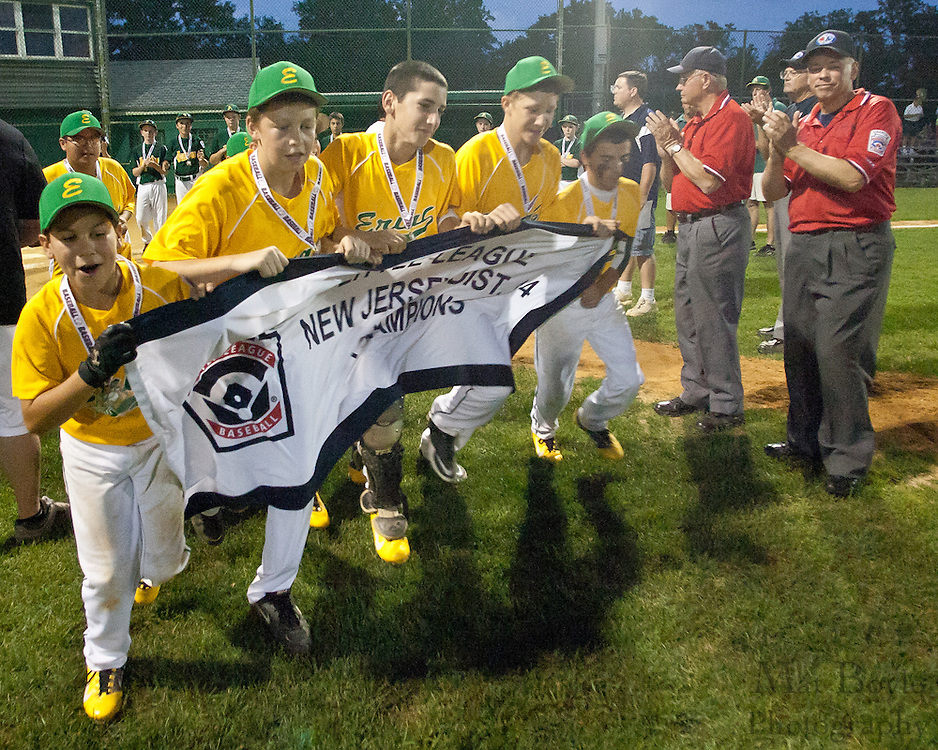 Erial takes a victory lap after winning the District 14 Little League final on Wednesday July 13th.