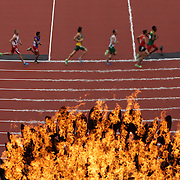 LONDON 2012 PARALYMPIC GAMES.. Pic shows runners going past the flame   at the London Paralympic Games,London.
