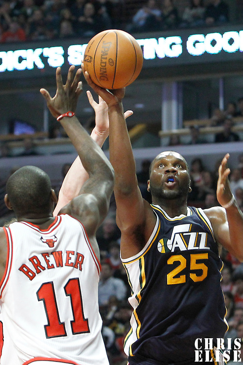 10 March 2012: Utah Jazz center Al Jefferson (25) goes for the layup past Chicago Bulls shooting guard Ronnie Brewer (11)  during the Chicago Bulls 111-97 victory over the Utah Jazz at the United Center, Chicago, Illinois, USA.