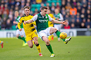 Paul Hanlon (#4) of Hibernian FC gets to the ball ahead of Nathan Flanagan (#16) of Raith Rovers FC during the William Hill Scottish Cup match between Hibernian FC and Raith Rovers FC at Easter Road Stadium, Edinburgh, Scotland on 9 February 2019.