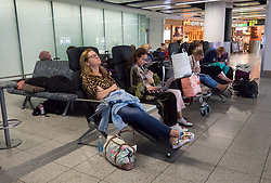 © Licensed to London News Pictures. 02/10/2017. Crawley, UK. Passengers wait at Gatwick Airport after it was announced that Monarch Airlines has ceased trading. The government has announced that it will start the country's biggest ever peacetime repatriation to fly about 110,000 stranded passengers home. Photo credit: Peter Macdiarmid/LNP
