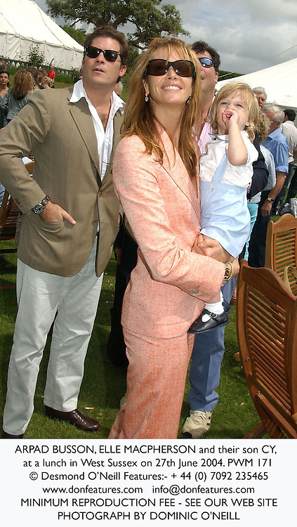 ARPAD BUSSON, ELLE MACPHERSON and their son CY, at a lunch in West Sussex on 27th June 2004.PWM 171
