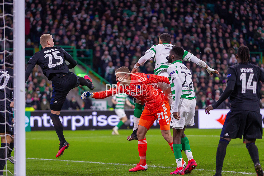 The foul that led to Celtic's goal being disallowed. Karl-Johan Johnsson of FC Copenhagen facing his own net when Christopher Jullien of Celtic FC jumps for the header during the Europa League match between Celtic and FC Copenhagen at Celtic Park, Glasgow, Scotland on 27 February 2020.