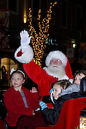 Santa arrives to begin the holiday season during the Santa parade and tree lighting celebration at The Greene towne square in Beavercreek, Saturday, November 19, 2011.