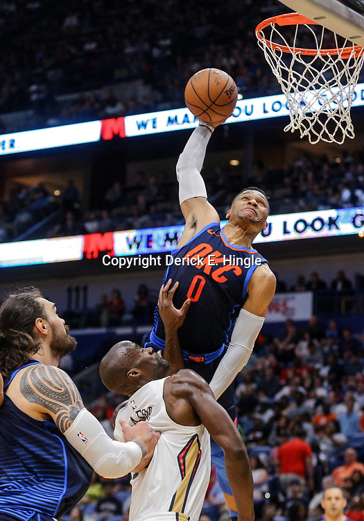 Apr 1, 2018; New Orleans, LA, USA; Oklahoma City Thunder guard Russell Westbrook (0) misses a dunk attempt as New Orleans Pelicans center Emeka Okafor (50) defends during the first quarter at the Smoothie King Center. Mandatory Credit: Derick E. Hingle-USA TODAY Sports