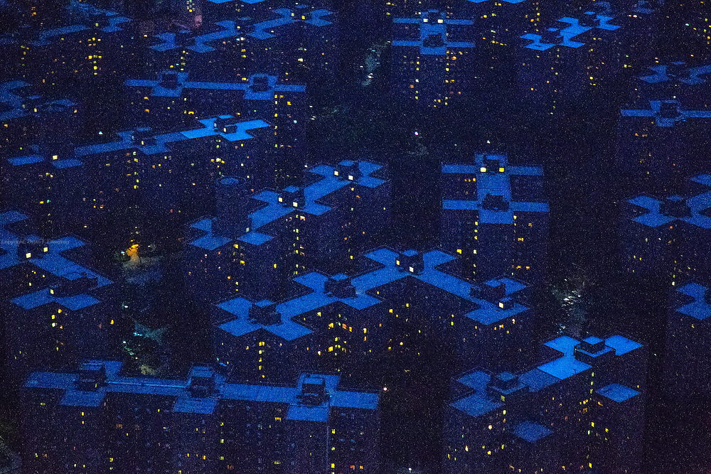 """Lights from apartments in the Stuyvesant Town- Peter Cooper Village breaks up the blue twilight in New York.<br />  """"New York City is a global leader when it comes to taking on climate change and reducing our environmental footprint. It's time that our investments catch up—and divestment from coal is where we must start,"""" Mayor Bill de Blasio said in a statement Tuesday September 29th, as he launched a campaign to remove the city's $160 million pension funds from coal investments.   <br /> The Mayor has already said he would reduce greenhouse emissions in New York with 40% by 2030 and ultimately with 80% by 2050.<br /> He is not the first New York Mayor to act on climate change. In a reaction to the G. W. Bush rejection of the Kyoto protocol back in 2005, former Mayor Michael J. Bloomberg was an early adapter of the """"US Mayors Climate Protection Agreement"""" initiated by then Seattle Mayor Greg Nickels. 1060 US Mayors ended up signing the agreement where they pledged to go meet or beat the greenhouse emission target in the Kyoto Protocol."""