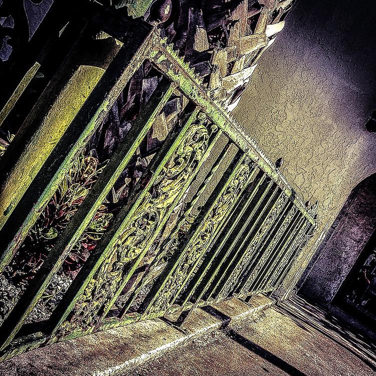 Iron fence outside La Tropicana, Ybor City (Tampa), Florida. Photo by Richard M. Porter
