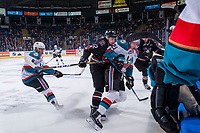 KELOWNA, CANADA - NOVEMBER 11: Chris Douglas #12 of the Red Deer Rebels checks Kyle Pow #21 of the Kelowna Rockets into the boards during first period on November 11, 2017 at Prospera Place in Kelowna, British Columbia, Canada.  (Photo by Marissa Baecker/Shoot the Breeze)  *** Local Caption ***
