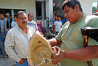 Mexico, Veracruz, Oct 27- Nov 4, 2009. For the last twenty-five years, Chicago resident Polo Garcia, a former dance teacher turned folklorist-ethnographer, has gone in search of the cultural traditions of Hispanic America, documenting for future generations indigenous dance movements so ritualized they are often passed on from memory by village elders. Using audio, video and still photography, Garcia spends up to half of each year abroad or in his native Mexico, returning with new material to instruct children as well as teachers in Chicago public schools.  <br /> Photographs commissioned by &quot;HOY&quot; newspaper. More at MexicoCulturalCalendar.com