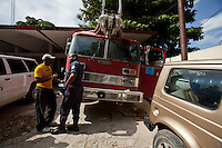 Nate Lasseur (left), a lieutenant with the West Palm Beach, Fla. Fire Department, speaks with Port-au-Prince Fire Chief Donald Grégory William at the Port-au-Prince fire station. Lasseur, an American of Haitian descent, is working to help better equip firefighters in underdeveloped countries through his International Firefighters Assistance organization. The building was heavily damaged in the January 12 earthquake and has been deemed uninhabitable and marked for demolition, though no one can say when that may be. William says he spends as little time as necessary inside the structure. A few dozen under-equipped firefighters are tasked with providing fire service to a damaged city of over two million people.