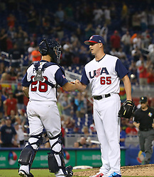 March 12, 2017 - Miami, FL, USA - United States pitcher Nate Jones celebrates with teammate catcher Buster Posey after defeating Canada 8-0 in a World Baseball Classic first round Pool C game on Sunday, March 12, 2017 at Marlins Park in Miami, Fla. (Credit Image: © David Santiago/TNS via ZUMA Wire)