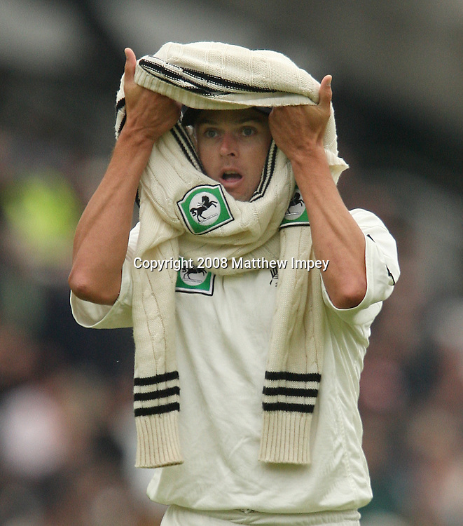Chris Martin the New Zealand fast bowler looks through his cricket sweater. England v New Zealand, Day 2, 1st Npower Test, Lord's Cricket Ground, St.Johns Wood, London. 16 May 2008. Photo: Matthew Impey/PHOTOSPORT