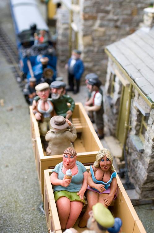 Miniature model railway outside in a garden, England, UK.