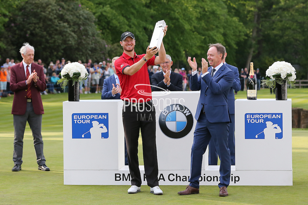 Chris Wood lifts the trophy during the BMW PGA Championship at Wentworth Club, Virginia Water, United Kingdom on 29 May 2016. Photo by Phil Duncan.