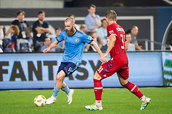 September 26, 2018 - Bronx, New York, US - New York City FC forward JO INGE BERGET (9) dribbles the ball against Chicago Fire midfielder BASTIAN SCHWEINSTEIGER (31) during a regular season match at Yankee Stadium in Bronx, New York.  New York City FC defeats Chicago Fire 2 to 0 (Credit Image: © Mark Smith/ZUMA Wire)