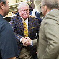 Jimmy Long, center, shakes hands with Raymond Jourdan during Long's retirement reception at MLM Clothiers in downtown Tupelo.