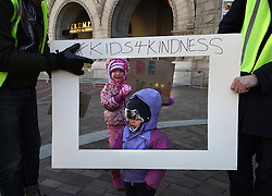 "December 10, 2016 - Washington, DC, USA - MAYA, 5 and ZOE, 1 have their picture taken inside frame of ''Photo Booth'' (Father asked not to use last name).  Children's Rally for Kindness takes place at Trump International Hotel in Washington DC on December 10, 2016 organized by the Takoma Parents Action Coalition.  According to their FaceBook page, it was a call to President-elect Donald Trump: ''to remember these lessons as he prepares to take office and implement policies that will affect the lives of children and families across our diverse nation.''.''All over the world, across cultures and countries, children learn the same basic lessons: .Ã'be kind,Ã"" .Ã'tell the truth,Ã"" .Ã'be fair,Ã"" .Ã'respect everyone,Ã"" .Ã'treat others the way you want to be treated,Ã"" .Ã'donÃ•t touch others if they donÃ•t want to be touched. (Credit Image: © Carol Guzy via ZUMA Wire)"
