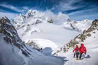 A pair of mountaineers as seen during descent of snowy coluoir of Aiguilles Marbrées.