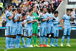 Manchester City players applaud before a minutes silence in memory of the two Newcastle fans killed in the MH17 air disaster. Liam Sweeney and John Alder were travelling to New Zealand to watch Newcastle play in a pre-season friendly tournament. - Photo mandatory by-line: Rogan Thomson/JMP - 07966 386802 17/08/2014 - SPORT - FOOTBALL - Newcastle, England - St James' Park - Newcastle United v Manchester City - Barclays Premier League.