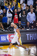 Golden State Warriors guard Klay Thompson (11) celebrates a three pointer against the Houston Rockets at Oracle Arena in Oakland, Calif., on October 17, 2017. (Stan Olszewski/Special to S.F. Examiner)