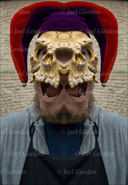 Fantasy portrait of young male adult dressed up and wearing  skull mask with Jester Hat taken the day before Halloween in New York City.
