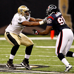 August 21, 2010; New Orleans, LA, USA; New Orleans Saints offensive tackle Charles Brown (71) blocks against Houston Texans defensive end Tim Jamison (96) during the second half of a 38-20 win by the New Orleans Saints over the Houston Texans during a preseason game at the Louisiana Superdome. Mandatory Credit: Derick E. Hingle