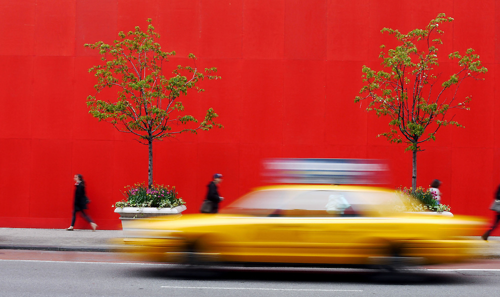 A yellow cab passes a red wall covering up the main display windows at Macy's Department store on 34th Street, New York, NY April 30, 2013. (Randall K. Wolf)